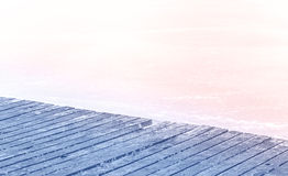 Rose quartz and serenity colors stylized wooden pier on frozen l Stock Photo