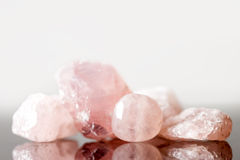 Rose quartz uncut and polished, crystal healing for love and hea. Rt, reflections Royalty Free Stock Images