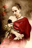 Rose queen. A rose queen - a woman grows a rose plant on the arm Stock Image
