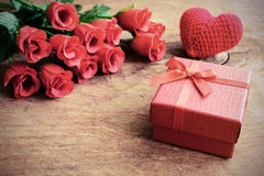 Rose with red gift box and red heart shape on wooden table Stock Image
