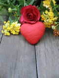 Rose and red heart on old wood background,colorful flowers Stock Photo
