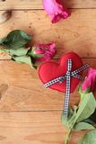 Rose with red hearts for Valentine's Day. Stock Photos