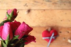 Rose with red hearts for Valentine's Day. Royalty Free Stock Photo