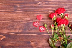 Rose with red petals with hearts for Valentine's Day on the boar Stock Photos