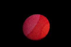 Rose red upholstery button. Close up of rose red textile upholstery button on black background Stock Images