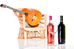 Rose and red wine bottle more a glass Stock Images