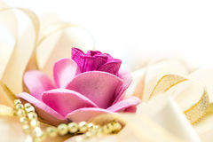 Rose and ribbon Stock Photography