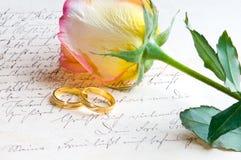 Rose, rings over handwritten letter Stock Photo