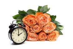 Rose roses and clock on pink background, daylight saving.  royalty free stock photography