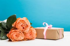 Rose roses with present on pink background, holiday, mother`s day, woman`s day - Image royalty free stock photography