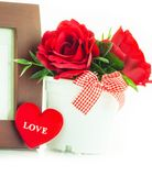 Rose rosse in un vaso Fotografie Stock Libere da Diritti