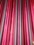 Rose, rouge, et fil gris de tissu Photographie stock