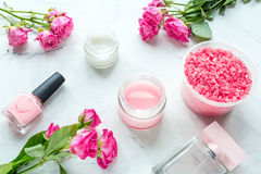 Rose salt and cream for nail care in spa on white background. Rose salt and cream for nail care in organic spa on white background royalty free stock photo