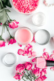 Rose salt and cream for nail care in spa on white background top view Stock Photo