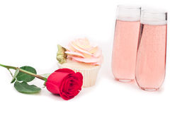 Rose shaped cupcake with champagne Stock Images