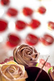 Rose shaped cupcakes. Iced cupcakes and drinks in the background Royalty Free Stock Photo