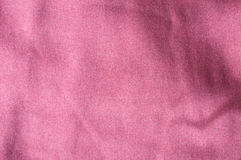 Rose silk cloth. Close up of rose silk textile, light folds Royalty Free Stock Photography