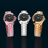 Rose, silver and gold watch on dark Stock Photos