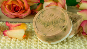Rose soap with rose petals and blooms Royalty Free Stock Photo