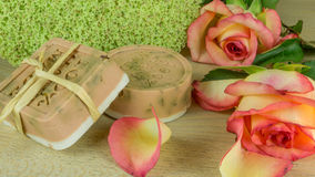 Rose soap with rose petals and blooms Royalty Free Stock Photography