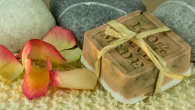 Rose soap with rose petals - Handmade. Rose soap with rose petals and blooms. Handmade stock image