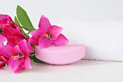 Rose soap, towel and flowers on white background Stock Photography