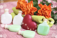 Rose spa. Towels, spa bottles, heart soap  and roses on a table Royalty Free Stock Images