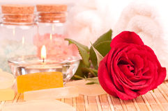Rose spa with bath salt and red rose close up Royalty Free Stock Photo