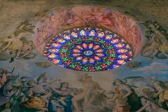 Rose stained-glass window in Todi Cathedral with frescoes Il Gi stock images