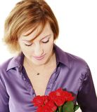Rose for a still woman. Close up of a smiling woman Royalty Free Stock Photos