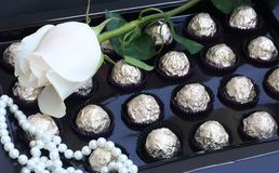 Rose, sweets and pearl. White rose, sweets and pearl Royalty Free Stock Photos
