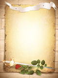 Rose and sword at burnt paper. Vintage grunge burnt paper at wooden background with red rose and sword Stock Photo