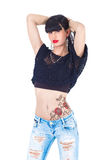 Rose tattoo. Beautifule woman in blue jeans and rose tattoo royalty free stock photo