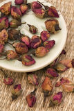 Rose Tea. Dried rosebuds like ingredient for green teas Stock Photography