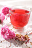 Rose tea. Flowers, and dried petals royalty free stock photography