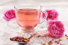 Rose tea. Flowers, and dried petals royalty free stock photos