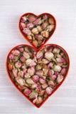 Rose tea buds in heart shape cutters Stock Photos
