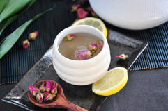 Rose Tea Cup with Spoon of Dried Roses. On tray stock photography