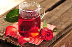 Rose tea. In glass mug, rose and petals royalty free stock photography