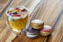 Rose tea and macaroons Stock Images