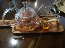 Rose tea. In teapot with honey stock images