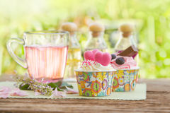 Rose tea  and sweet cupcake Stock Photography