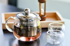 Rose tea or tea pot. And cups royalty free stock photography