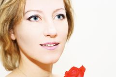 Rose for tender woman. Close up of a smiling woman over white Royalty Free Stock Images