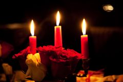 Rose and three candles Stock Images