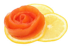 Rose of tomato on a slice of lemon Stock Images