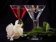 Rose and two glasses of cocktails. On a white background Royalty Free Stock Image