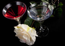 Rose and two glasses of cocktails Royalty Free Stock Image