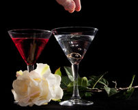 Rose and two glasses of cocktails Stock Photos