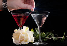 Rose and two glasses of cocktails Royalty Free Stock Images